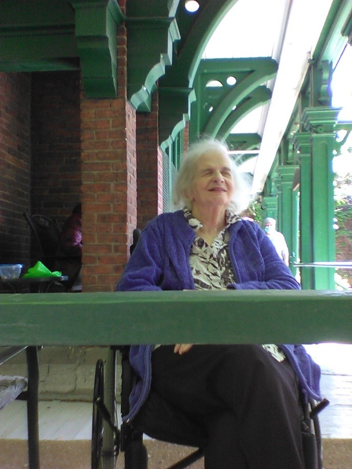 Photo of Sharon Holcroft sitting outside of the Fulford Residence